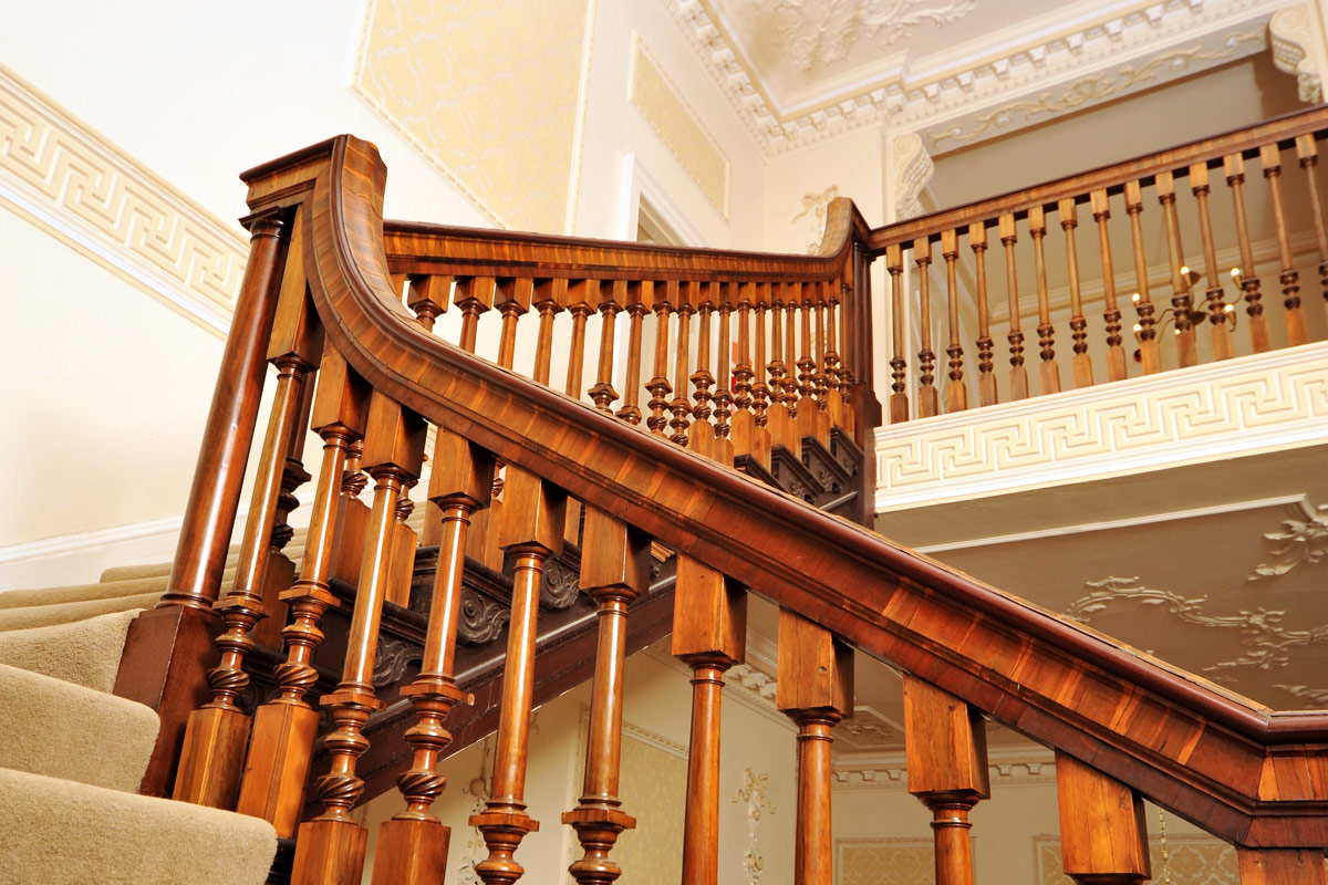 wooden railings of a staircase leading up to the first floor